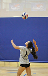 MCC player hitting volleyball