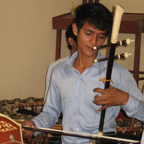 Man playing string instrument Cambodia